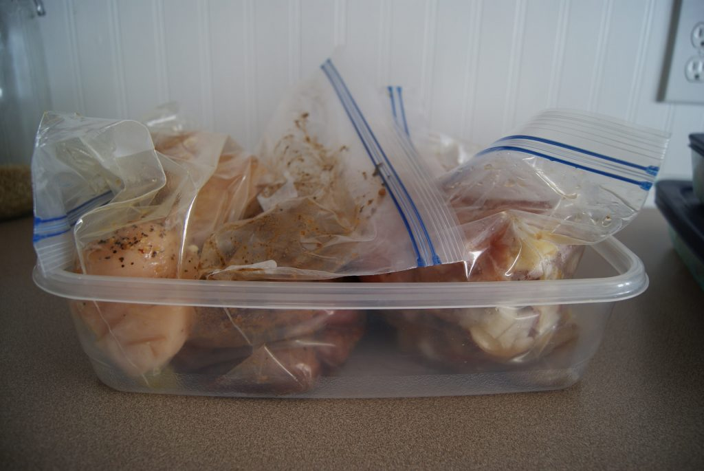 Meals prepped and in plastic bags placed in a plastic container to help with organization.