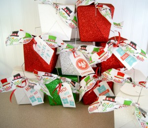 Many Christmas decorated to go boxes stacked on top of each other.