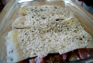 Chicken with cream cheese topped with swiss cheese, ham, and bread crumbs.