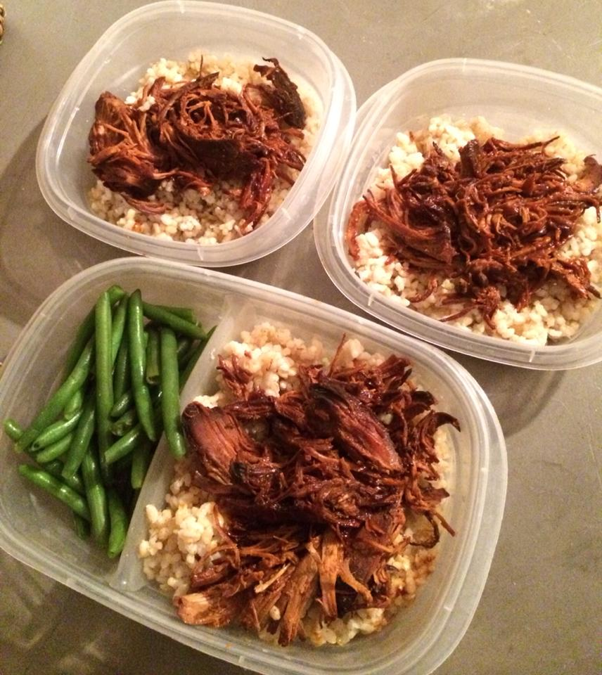 Three containers, two with brown rice topped with shredded beef, and the third with brown rice topped with shredded beef,but with a side of green beans.