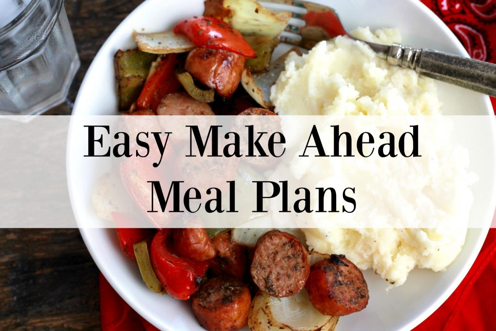 A white plate with sliced sausage, mixed vegetables and a side of mashed potatoes.