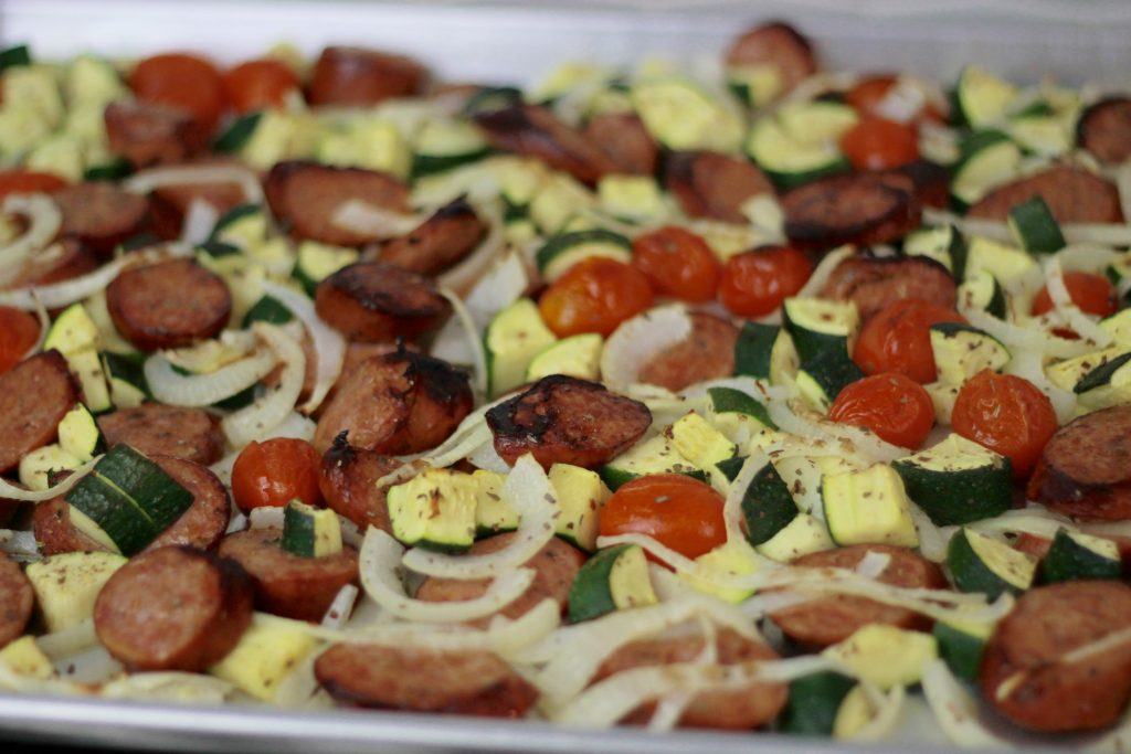Cooked sausage, zucchini, petite tomatoes and chopped onions all in one pan.