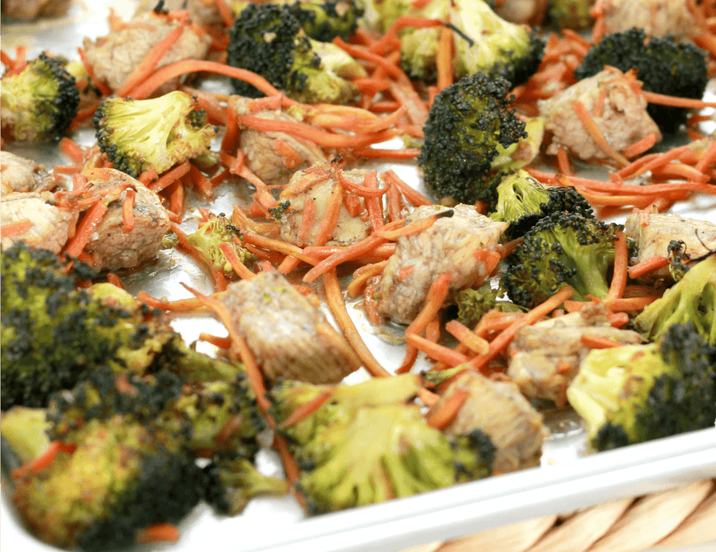 Oven baked chicken, broccoli, and sliced carousal in one pan ready to be served.