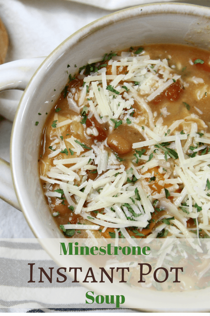 Instant pot Minestrone soup topped with cheese in a white bowl.