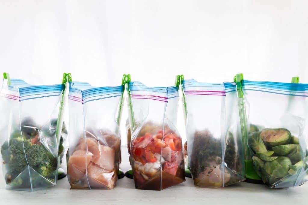 5 ziplock baggies in baggie stands with ingredients for dinner