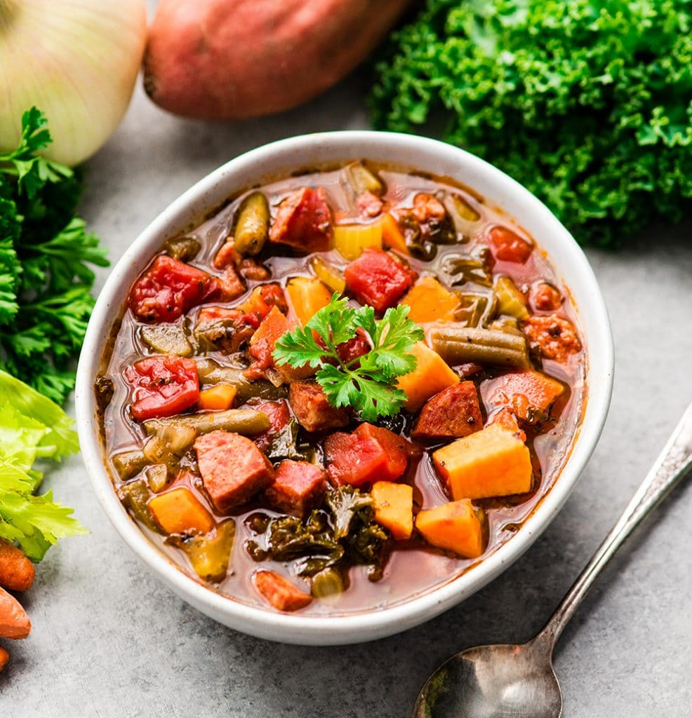 Sausage Kale Soup with sweet potato and green beans in a bowl